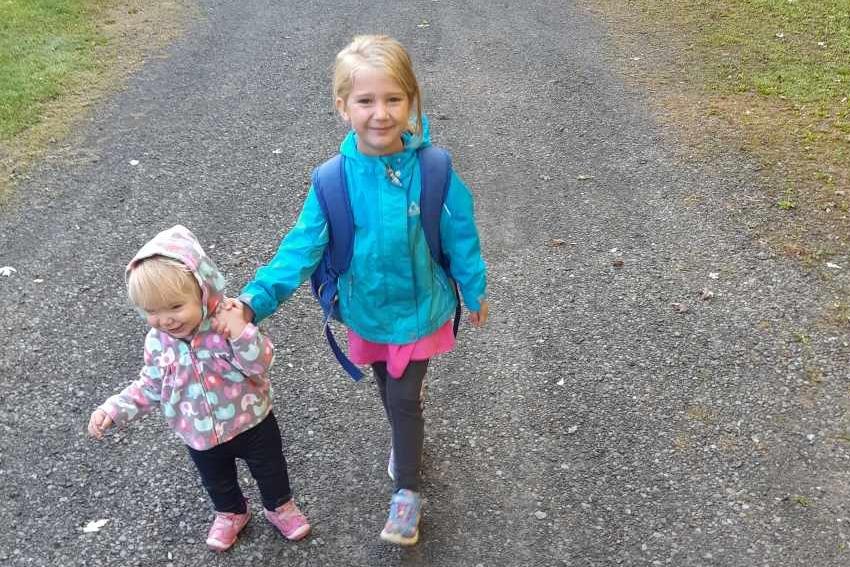 2 little girls walking down path
