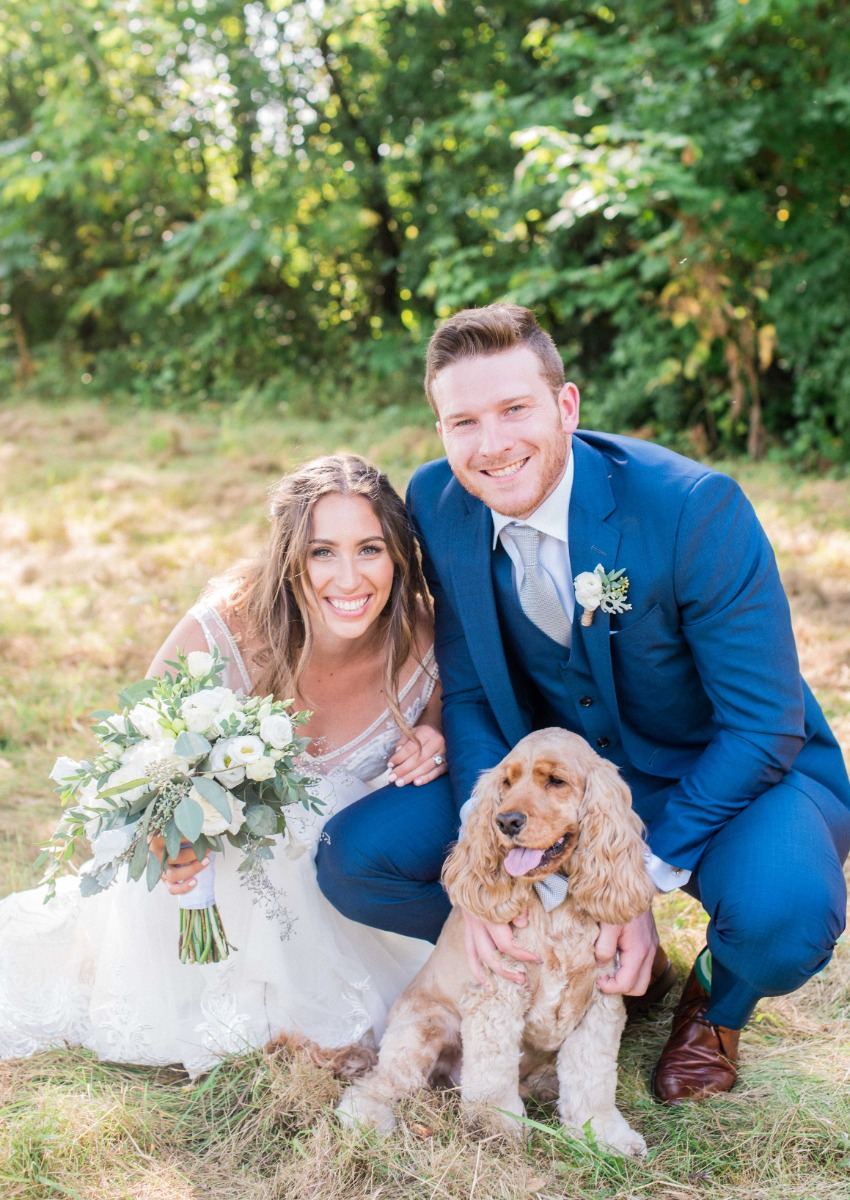 Dr Peter Wise with wife and dog at wedding