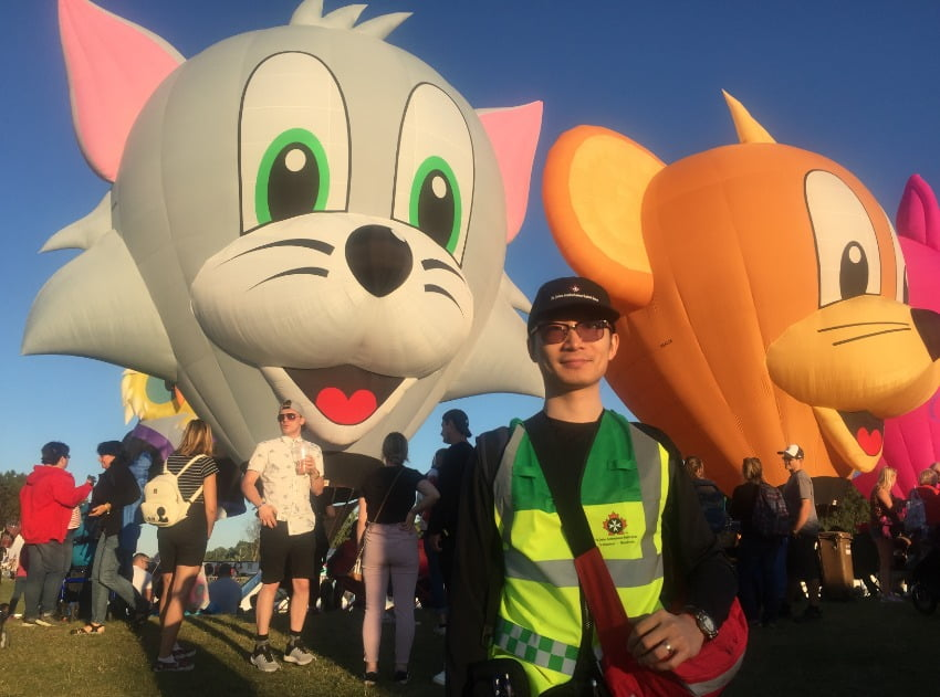 Zack Song paramedic infront of hot air balloons